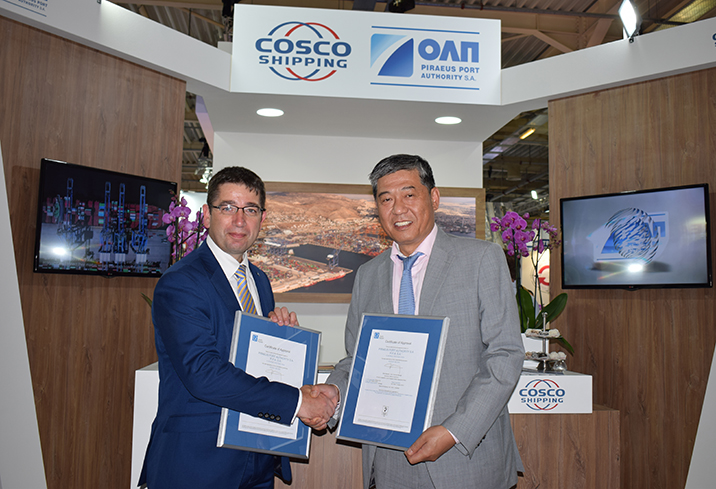 LR's Nick Brown presents certificates to Capt. Weng Lin of PPA at Posidonia