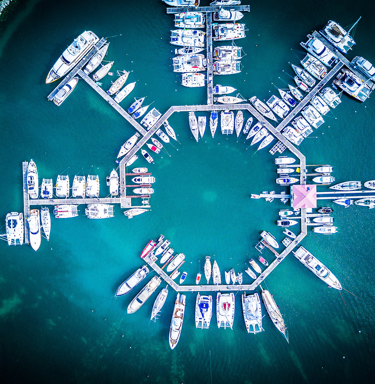 Ariel view of yachts in dock. Location unknown.